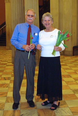 Photo of two people holding red tulips at SC State House