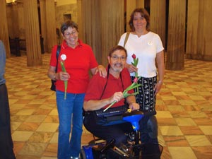 Photo of three family members holding red tulips at SC State House