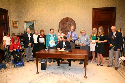 Group photo of Parkinson community watching Governor Sanford signing proclamation