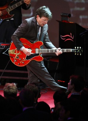 Michael J. Fox playing a guitar